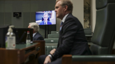 MP for Groom, John McVeigh, is seen on a screen as Speaker Tony Smith meets with the remote Parliament team.