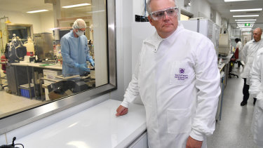 Prime Minister Scott Morrison during a tour of the University of Queensland Vaccine Lab in October, before the government ended its collaboration.