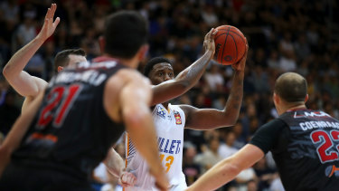 Lamar Patterson of the Bullets looks to pass during the round five NBL match against the Hawks at AIS Arena in Canberra.