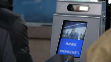 "The screen displays ""Verification is made. Please open the gate after collecting ID card""."