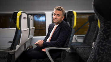 Transport Minister Andrew Constance says the fixed seats allow passengers to have features such as tray tables and charge points for mobile phones.