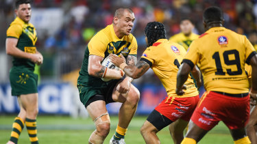 On the front foot: David Klemmer runs into some willing Kumuls defence.