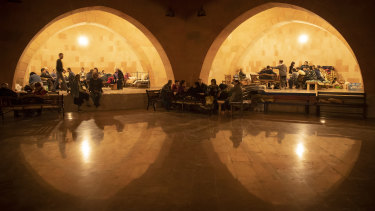 People take refuge in a bomb shelter in Stepanakert, the self-proclaimed Republic of Nagorno-Karabakh, Azerbaijan.