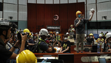 Students break into the Hong Kong Legislative Chamber to protest against an extradition bill in July 2019.