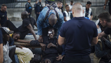 A migrant is injured after minor clashes with French police officers at the Panthenon in Paris.
