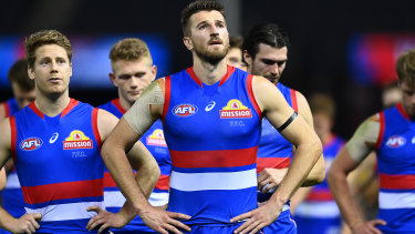 Marcus Bontempelli and his Western Bulldogs teammates following their loss to Port Adelaide at Marvel Stadium.