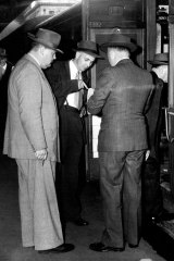 Detectives outside the carriage where Perkman's body was found. February 20, 1954