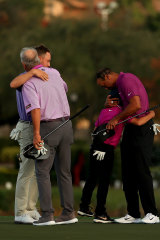 Tiger Woods of the United States hugs son Charlie Woods as  Justin Thomas of the United States hugs dad Mike Thomas on the 18th hole during the first round of the PNC Championship at the Ritz Carlton Golf Club on December 19, 2020 in Orlando, Florida.