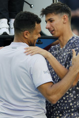 Alexei Popyrin consoles Jo-Wilfried Tsonga after the Frenchman pulled out of their match.