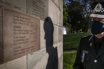 Chief Commissioner Shane Patton in front of the new memorial plaque for the four police officers.