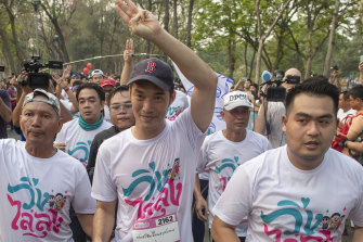 Leader of the anti-military Future Forward Party Thanathorn Juangroongruangkit, centre, is surrounded by his supporters during the run.