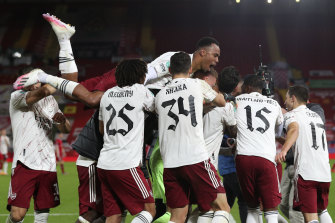Arsenal celebrate their penalty shootout victory over Liverpool in their League Cup fourth-round clash.