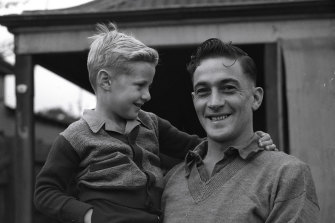 Private Ernest McDonaldof Cammeray with his five-year-old son Paul, who wasa baby when his father sailed for the Middle East. 29 October 1944