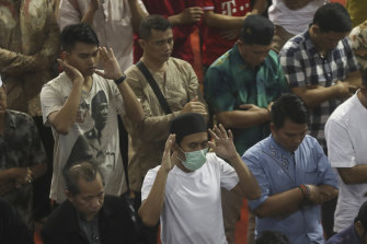 A man wears a mask during Friday prayers in Indonesia, despite claims the coronavirus is not present in the country.
