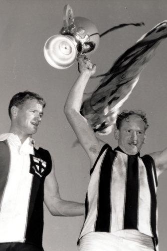 Flashback: Collingwood captain Des Tuddenham (left) and St Kilda skipper Darrel Baldock after swapping jumpers.