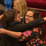 Members of the Victorian Upper house celebrate with hugs and tears of joy after a marathon 29 hours sitting to pass the Voluntary Assisted Dying Bill in November 2017.