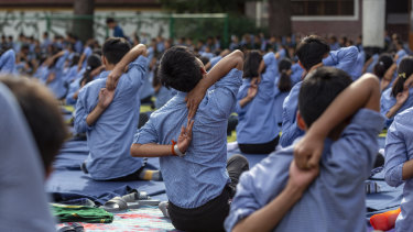Tibetan student practise yoga at the Tibetan Children's Village School in Dharmsala, India