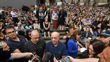 Aiia Maasarwe's father Saeed (centre) joined a vigil at Parliament House on Friday night for his daughter, attended by more than 1000 people.