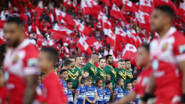 The Kangaroos surrounded by red and white flags before kick-off.
