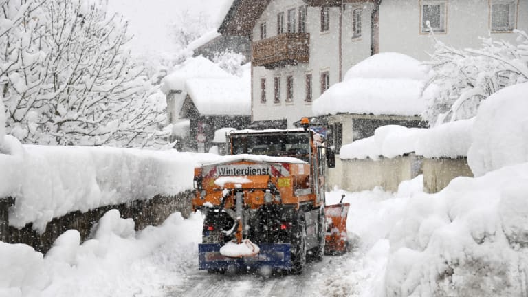A snow plough cleans a street in Berchtesgaden, southern Germany.
