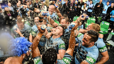 Party time: NSW players celebrate in the sheds after the match.