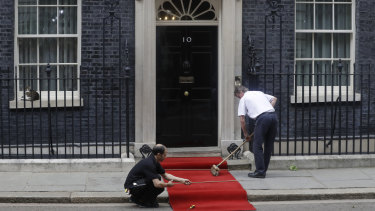 The red carpet is rolled out outside 10 Downing Street.