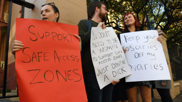 Demonstrators in favour of no-go zones around NSW abortion clinics stand outside NSW State Parliament on Thursday.