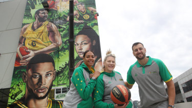 Liz Cambage, Lauren Jackson and Andrew Bogut pose in front of the Marvel Stadium mural.