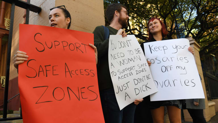 Demonstrators in favour of no-go zones around NSW abortion clinics stand outside NSW State Parliament last week.