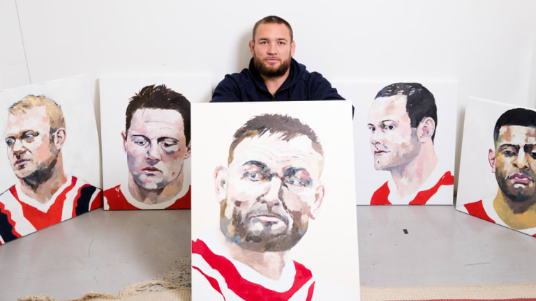 Jared Waerea-Hargreaves with the paintings of players which will be auctioned post-season.