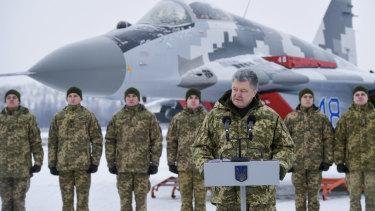 Ukrainian President Petro Poroshenko addresses the Armed Forces of Ukraine at the military airfield in the Vasylkiv region, Ukraine, on Saturday.