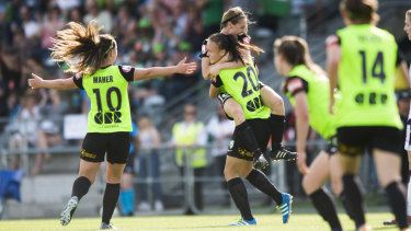 Karly Roestbakken celebrates a goal for Canberra United last season.