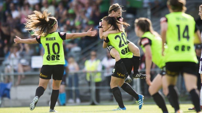 Karly Roestbakken celebrates a goal for Canberra United last season.