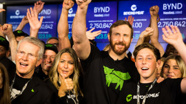 Ethan Brown, founder and chief executive officer of Beyond Meat, center, celebrates with his wife Tracy Brown, center left, and guests during the company's IPO at the Nasdaq MarketSite in New York.