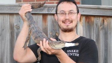 Snake hunter Mark Pelley captured a freshwater crocodile in Heidelberg in Melbourne on Christmas Day, 2017.