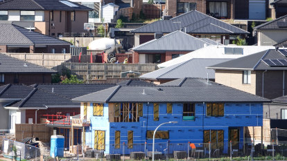 Surging property prices could force RBA to reassess ultra-low rates, economists warn