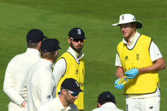 Stuart Broad speaks to teammates during a break in play on day three  of the Test match against the West Indies in Southampton.