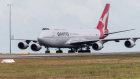 A qantas charter flight arrives at Darwin International Airport.