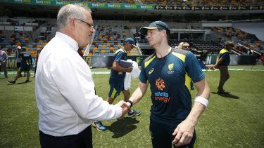 Prime Minister Scott Morrison greets Steve Smith at the Gabba.