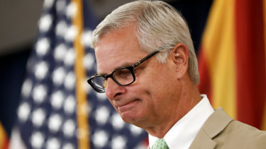 Rick Davis, spokesperson for Senator John McCain's family, reacts as he speaks to the media during a news conference.
