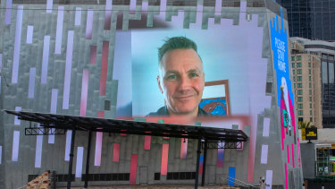 Federation Square CEO Xavier Csar projected on the screen of a deserted Fed Square.