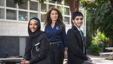 Scholarship winners Zamzam Ahmed and Jordan Zammitt with their principal Elaine Hazim.