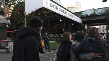 Police evacuate the nearby Borough Market, which was the scene of a terrorist attack in 2017.