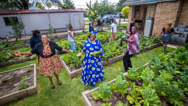 SelbaGondoza Luka, Rita Padang and Veronica Agobong with other community members in the community garden.