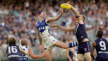 Hop to it: Kangaroo Todd Goldstein springs into a contest against Sean Darcy of the Dockers.
