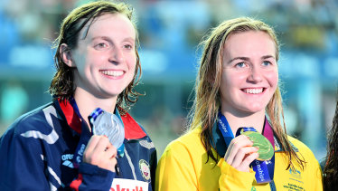 Ariarne Titmus and Katie Ledecky show off their medals after the 400m final.