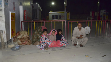 A Quetta family gathers outside the house following a severe earthquake that hit an area about 100km from the city on Thursday.