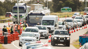 Ring of steel: Police stop cars heading into regional Victoria at Geelong.