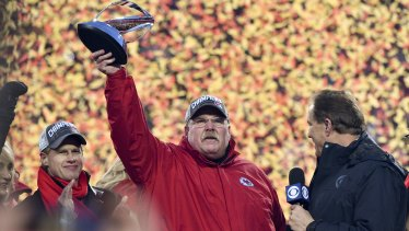 Reid holds up the Lamar Hunt Trophy after beating the Tennessee Titans to take out the AFC Championship.