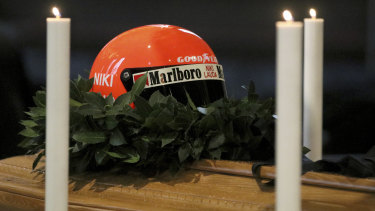 Farewell: Niki Lauda's racing helmet placed atop his coffin.